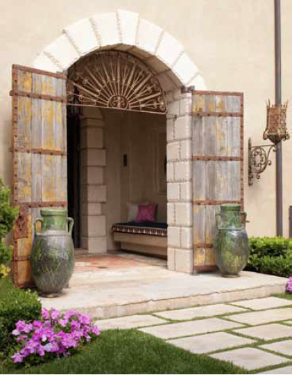 Antique doors and iron grill arch sourced from Morocco. Front entrance.